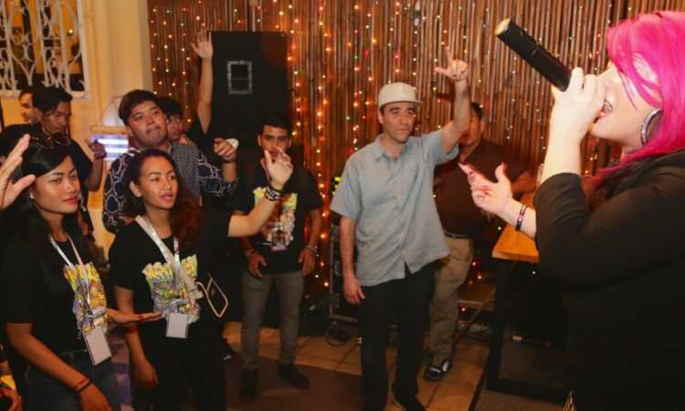 American rapper Pinqy Ring works the crowd at an impromptu concert during a reception this week to welcome a group of hip hop artists to Cambodia. [U.S. Embassy photo by Un Yarat]